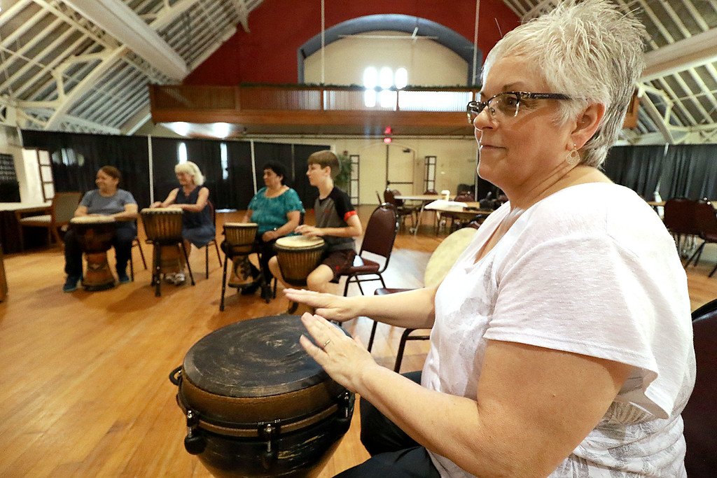 . The Fitchburg Senior Center had drum teacher Tim Kane in on Wednesday morning to teach a class in drumming. Kathy Cote participates in the class at the center. SENTINEL & ENTERPRISE/JOHN LOVE