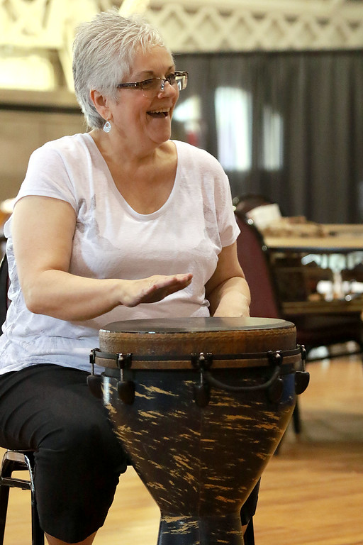 . The Fitchburg Senior Center had drum teacher Tim Kane in on Wednesday morning to teach a class in drumming. Kathy Cote participates in the class. SENTINEL & ENTERPRISE/JOHN LOVE