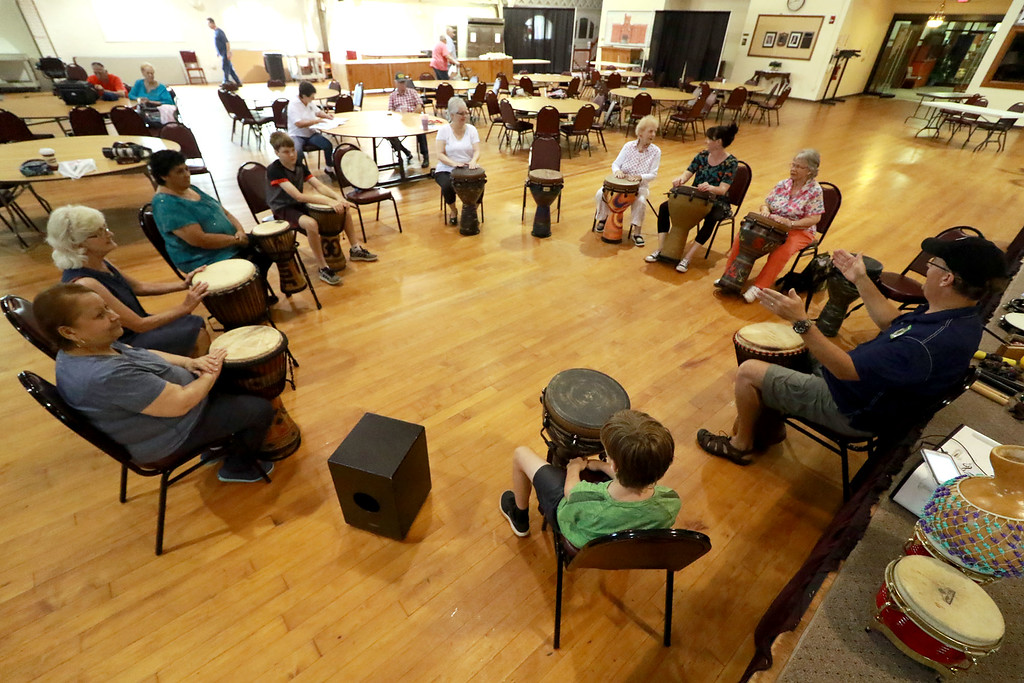 . The Fitchburg Senior Center had drum teacher Tim Kane in on Wednesday morning to teach a class in drumming. Kane, on right, talks to the group about the drums during the program. SENTINEL & ENTERPRISE/JOHN LOVE