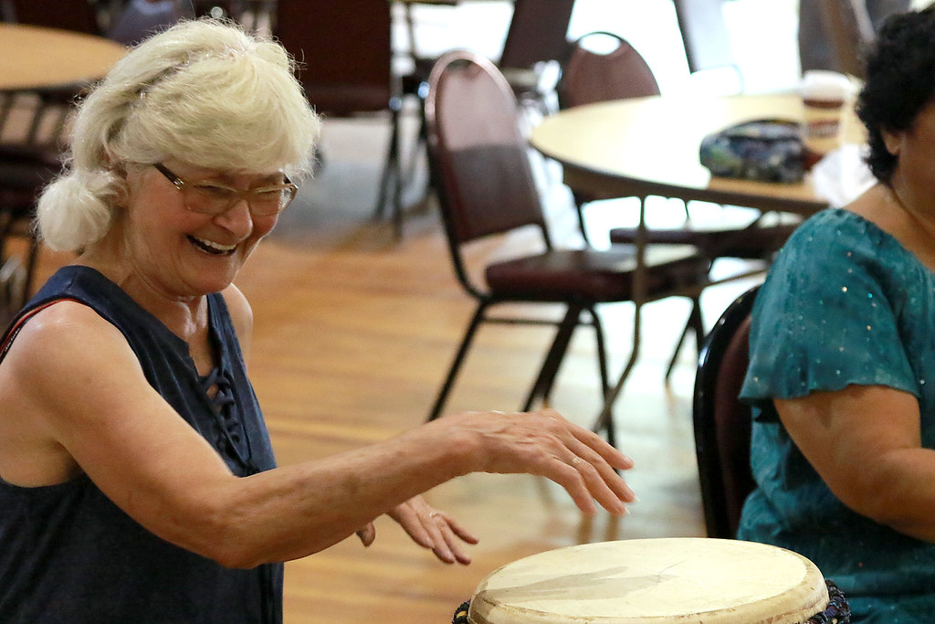 . The Fitchburg Senior Center had drum teacher Tim Kane in on Wednesday morning to teach a class in drumming. Elaine Legay has a good time while participating in the class. SENTINEL & ENTERPRISE/JOHN LOVE