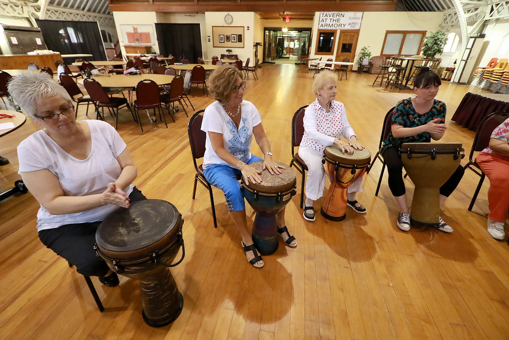 . The Fitchburg Senior Center had drum teacher Tim Kane in on Wednesday morning to teach a class in drumming. Many participated in the class. SENTINEL & ENTERPRISE/JOHN LOVE