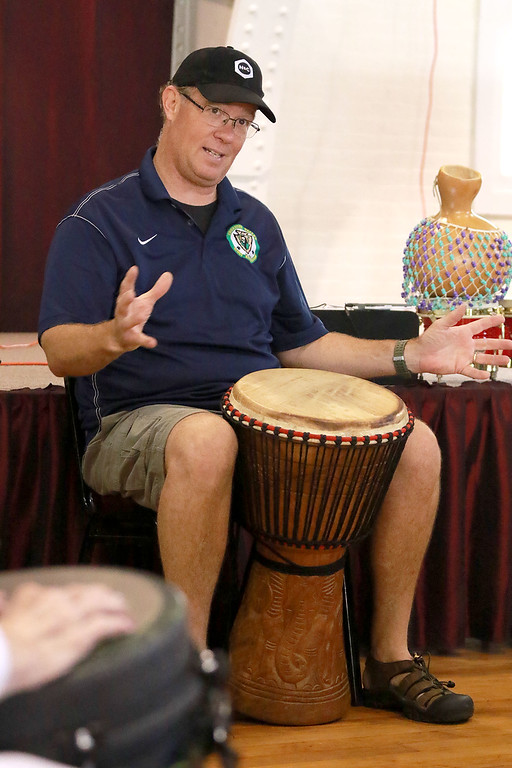 . The Fitchburg Senior Center had drum teacher Tim Kane, pictured, in on Wednesday morning to teach a class in drumming. SENTINEL & ENTERPRISE/JOHN LOVE