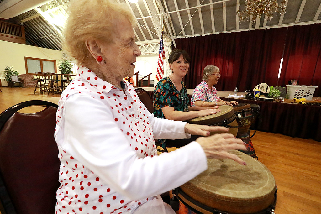. The Fitchburg Senior Center had drum teacher Tim Kane in on Wednesday morning to teach a class in drumming. Josie Cormier participates in the class at the center. SENTINEL & ENTERPRISE/JOHN LOVE