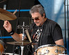 Jim Keltner perfoms with T Bone Burnett at the New Orleans Jazz & Heritage Festival on April 27, 2007.
