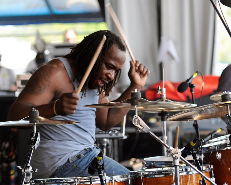"""Desmond """"Milk"""" Williams performing with Big Sam's Funky Nation at the New Orleans Jazz & Heritage Festival on April 25, 2009."""