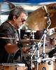Jim Keltner performs with T Bone Burnett at the New Orleans Jazz & Heritage Festival on April 27, 2007.