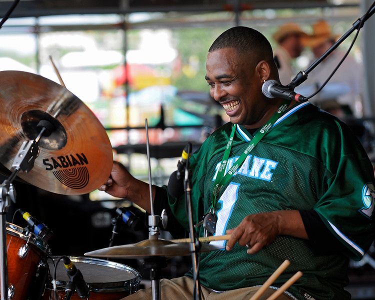 "Russell Batiste performing live with Joe Krown and Walter ""Wolfman"" Washington at the New Orleans Jazz & Heritage Festival on April 25, 2009."