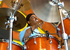 Russell Batiste perfoms live at the New Orleans Jazz & Heritage Festival on April 26, 2003.