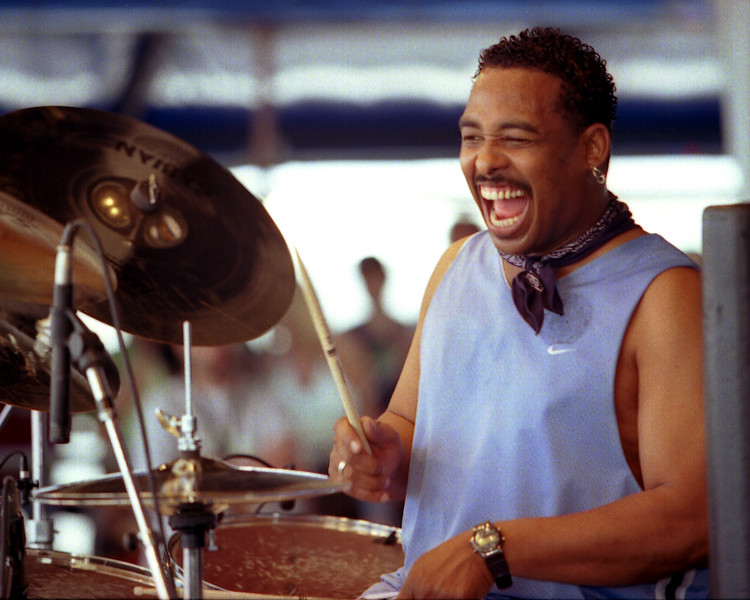 Russell Batiste, Jr. performing with George Porter's Runnin' Pardners at the New Orleans Jazz & Heritage Festival on May 5, 2001.