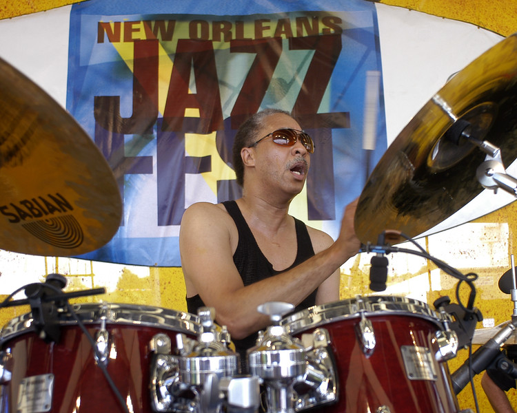 NEW ORLEANS, LA-MAY 4: Zigaboo Modeliste performing with the Wild Magnolias at the New Orleans Jazz & Heritage Festival on May 4, 2003. (Photo by Clayton Call/Redferns)