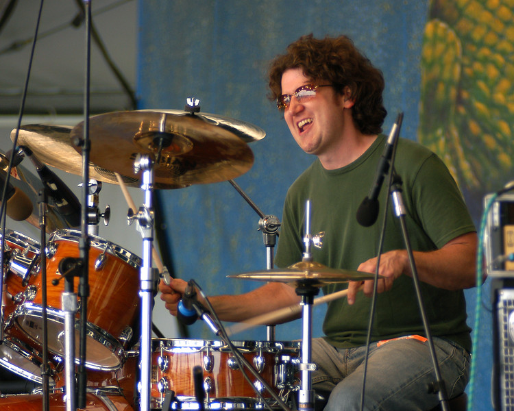 Doug Belote (Jerry Douglas, Larry Carlton) performs with the Wild Magnolias at the New Orleans Jazz & Heritage Festival on May 2, 2004.