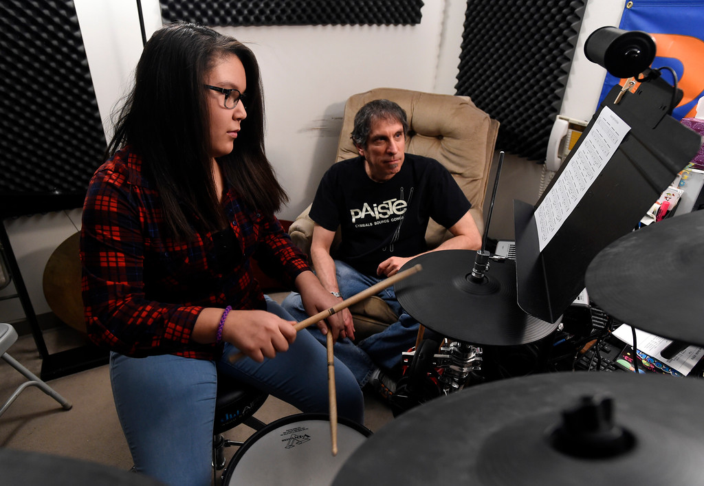 . Owner and instructor Larry Bennett gives drum lessons to Casey Middle School 6th-grader Anastasia Martinez at the Boulder Drum Studio on Friday in Boulder. For more photos of drum lessons at the Boulder Drum Studio go to www.dailycamera.com Jeremy Papasso/ Staff Photographer/ Jan. 13, 2017