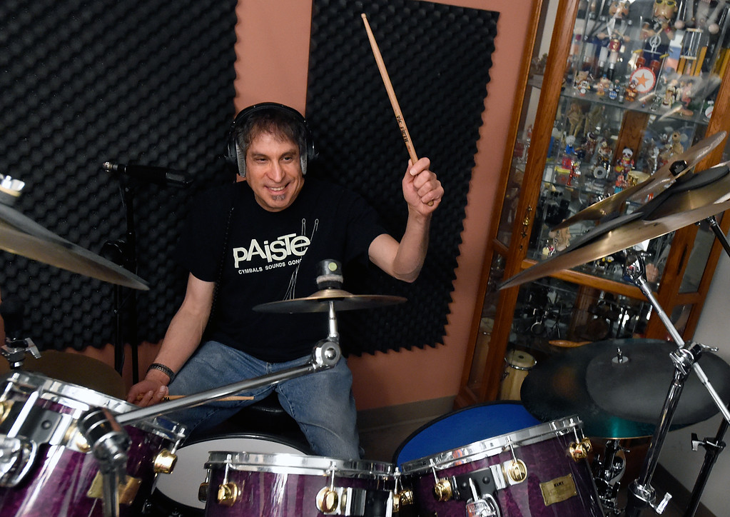 . Owner and instructor Larry Bennett plays the drums while teaching a lesson at the Boulder Drum Studio on Friday in Boulder. For more photos of drum lessons at the Boulder Drum Studio go to www.dailycamera.com Jeremy Papasso/ Staff Photographer/ Jan. 13, 2017