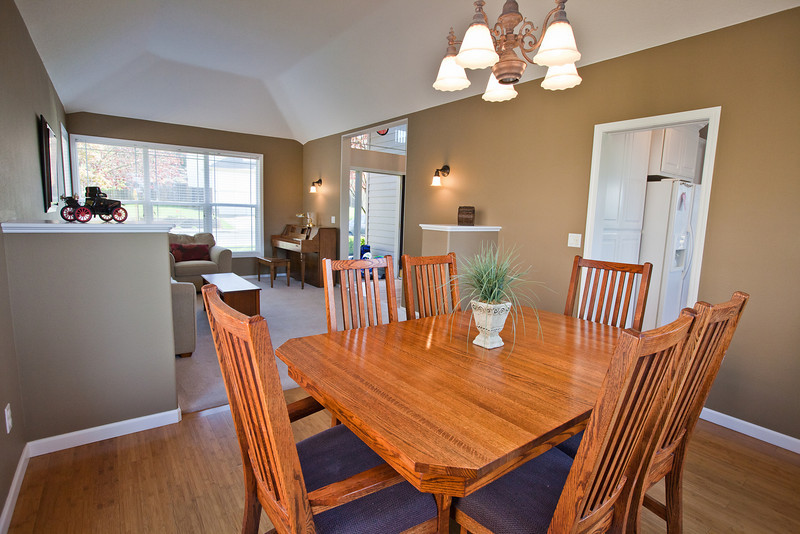 View of the dining room. Two built in cabinets separate the Front Room from the dining room. The door on the right is a pocket door that separates the dining room from the kitchen.