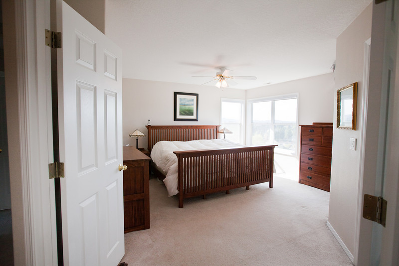 Alternate view of the main bedroom with king bed (for reference).