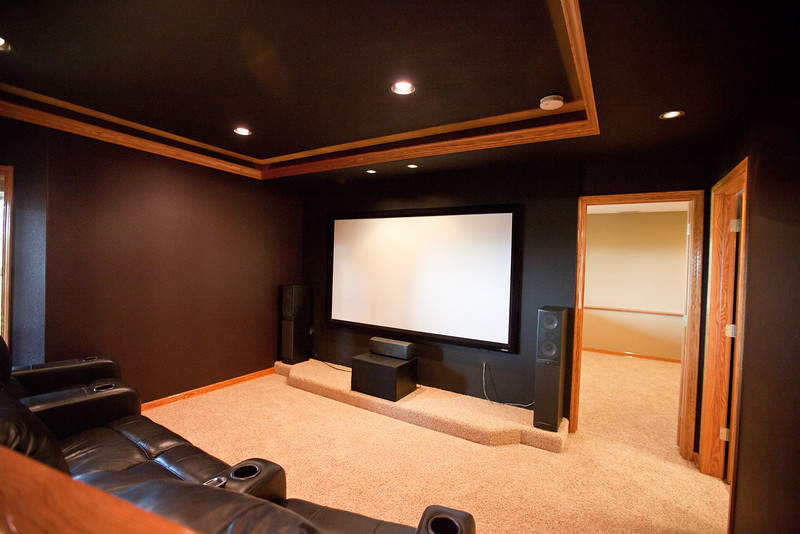 This is the view from the media bar of the 100in screen. This room is completely wired for 7.1 surround sound as well as complete remote control of all AV components (everything is hidden in a ventilated closet). The crown moldings enclose a soffit light that provides theater lighting when in use. All lighting is remote controlled from the media seating.  The doorway to the right leads to the fourth bedroom and the other doorway on the right leads to the third full bathroom, making for the perfect mother in law or teenager floor. Extensive sound control techniques were deployed in the construction of this floor including double drywall and green glue to minimize noise transmission between the downstairs and the main floor.