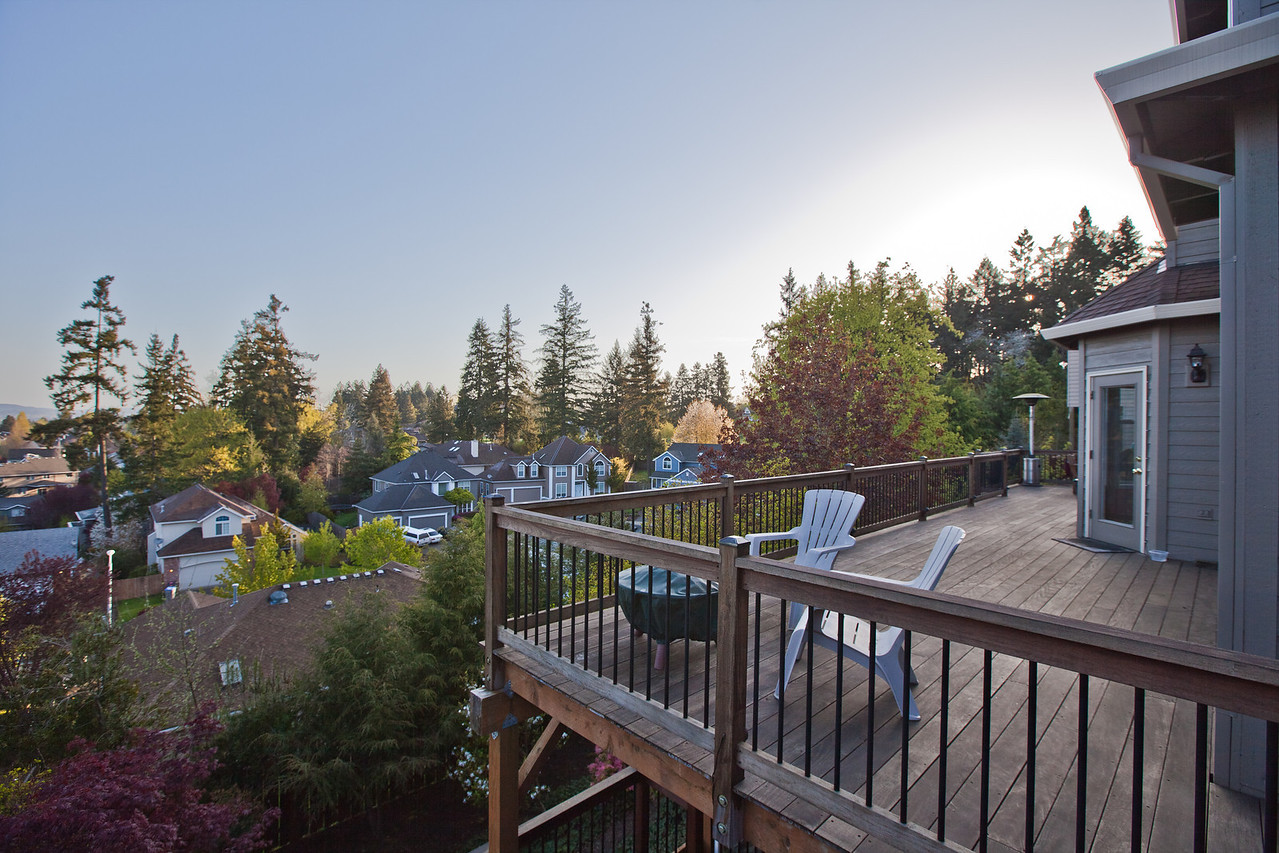 Full Length IPE (hardwood) deck provides gorgeous views toward the northwest and the opportunity to watch the sunset in the evenings. Deck is lighted for easy night access to the backyard. Deck is naturally fire resistant and low maintenance due to the species of wood.