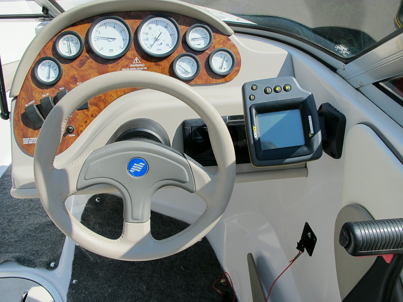 Original instrument panel, includes a Hummingbird fish finder and an alpine stereo.
