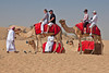 Couples getting ready for their camel ride in the Arabian Desert.