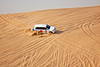Vehicles used to fly and skid all over the Arabian dunes as part of a Desert Safari.