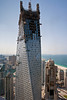 """""""Twisted Building"""" in building process with Jumeirah Beach in the background."""