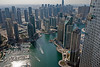 """Sun reflecting off water in Dubai Marina with """"Twisted Building"""" to the right in the photo."""