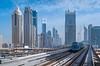 Tall buildings and the Metro train track in downtown Dubai, UAE, Middle East.