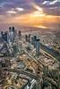 Sunset and the city skyline from Burj Khalifa in Dubai, UAE, Middle East.