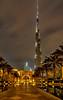 The Burj Khalifa and Palace Hotel illuminated at night in downtown Dubai, UAE, Middle East.