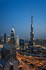 The Burj Khalifa and city skyline at night in downtown Dubai, UAE, Middle East.