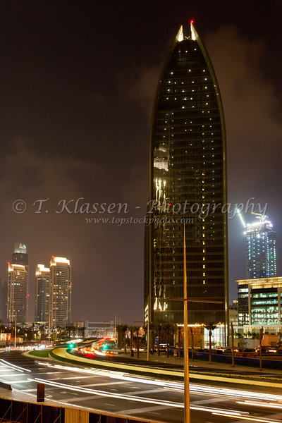 A high rise building in Dubai, UAE illuminated at night.