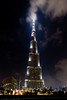 The Burj Al Kahlifa tower illuminated at night near the Dubai Mall in Dubai, UAE.