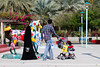 Muslims in traditional dress at Jumeirah Beach Park in Dubai, UAE.