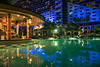 The pool and bar at the Jumeirah Beach Hotel at night in Dubai, UAE, Middle East.