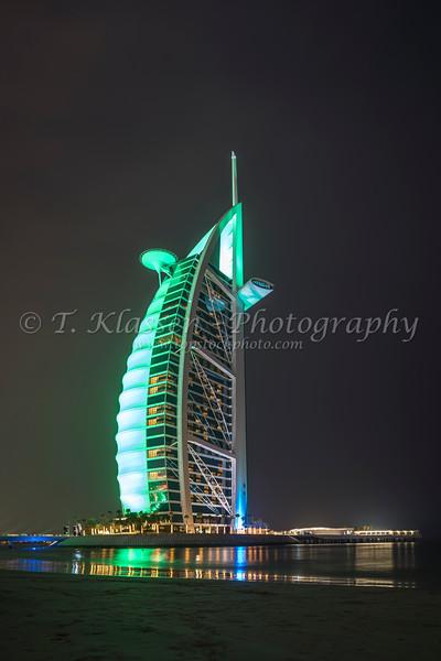 The Burj Al Arab illuminated at night in Dubai, UAE, Middle East.