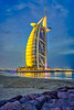 The Burj Al Arab illuminated at night in Dubai, UAE, Middle East.