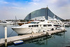 Boats in the marina and the Jumeirah Beach Hotel in Dubai, UAE, MIddle East.