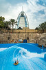Wave surfing at the Wild Wadi waterpark, Dubai, UAE, Middle East.