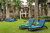 Blue beach loungers on the lawn at the Jumeirah Beach resorts in Dubai, UAE, Middle East.