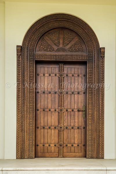 A wooden door to a residence near  Kite Beach, Dubai, UAE, Middle East.