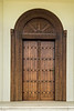A wooden door to a residence near  Kite Beach, Dubai, UAE, Middle East.