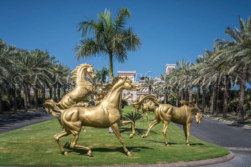 Golden horses at the entrance to a Madinat Jumeirah resort in Dubai, UAE, Middle East.