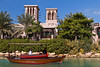 The Madinat Jumeirah with canals and tropical vegetation in Dubai, UAE.