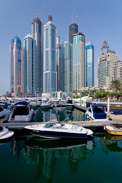 The Dubai Marina with high rise buildings and boats in Dubai, UAE, Persian Gulf.
