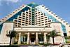 The exterior front facade of the pyramid shaped Raffles Dubai Hotel in Dubai, UAE.