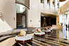 The interior lobby of the Raffles Dubai Hotel in Dubai, UAE.