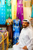 An Arab man in a dress shop in the markets of Dubai, UAE.