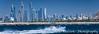 A pleasure boat and the Marina skyline off the coast of Dubai, UAE, Middle East.