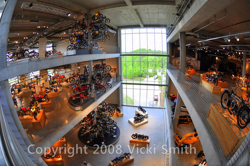 "The creativity in displays includes these motorcycle ""trees"" which from this angle seem to have grown up thru the floors"