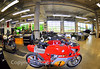 The basement workshop features overhead doors that lead out to the racetrack. Museum cars and bikes are driven around the racetrack at the lunch break.  Today's choice was a screaming loud Phil Reed MV Agusta